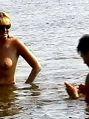 This blonde nudist looks irresistible when posing in her sunglasses