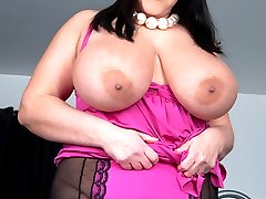 Carol Brown plays with her huge tits and toy pounds her twat