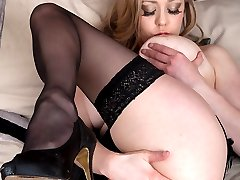 Sapphire plays with her large juggs and dildo fucks her twat