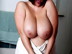 Roxy Anderson lathers up her puppies and pussy in the shower
