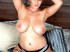 Lexy plays with her giant boobs and showing her shaved pussy