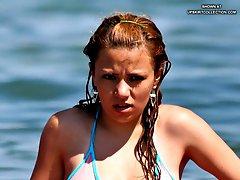 Enjoy hard nipples sticking under girls wet bikinis