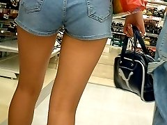 Camera guy spies bubble butts wrapped in tight shorts