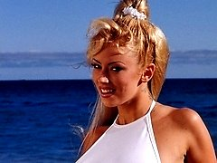 Jenna Jameson on a sandy beach naked