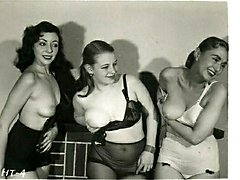 A group of retro girls shake tits to the camera