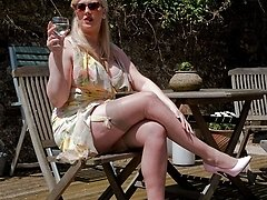 Big-boobed, ash-blonde Michelle having joy in the sun in summer dress and ff nylons!