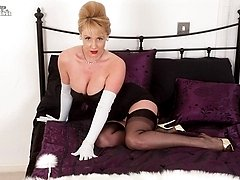 Glamorious Clair strips in furs and nylon