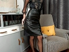 Mercedes in her leather skirt, full corselette and black ff nylons!
