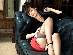 Kate Anne gets her hairy snatch out in a teasy strip routine in the lounge!