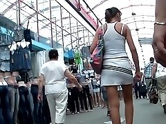 Long legs of amateurs stretched up skirt