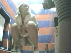 Raunchy hotties urinates onto spy cam in public loo