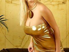 Raylene Richards posing in a gold sundress and black stockings