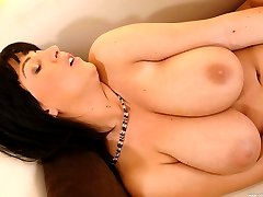 Busty babe Kora shows her tits