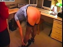 Stocking clad nurse touches her toes to receive a blistering paddling on her naked upturned ass