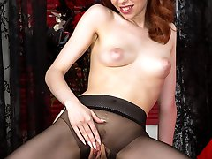 Poppy brings a sexy pair of real designer seamless black pantyhose to play in on her bed.