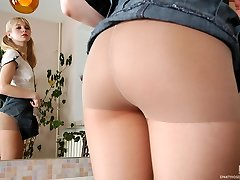 Ponytailed blonde takes off her sheer control top stocking and sniffs them