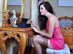 Cute hairy brunette in a pink nighty and tan nylons stretches her asshole