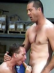 Tough looking gay workers Karl and Dan flexing their hard muscles while swallowing dicks