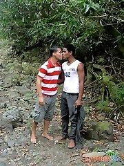 Brown-skinned gay guys milk dicks by the stream