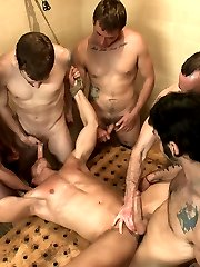 Alex Adams was gangbanged and publicly humiliated at the boxing gym but the guys aren't through with him yet.  They drag his ass to the locker room where the horny men hold him down while he takes hot cum on his face.  Alex is made to suck every cock around him before the men bend over and make him eat their holes. He tries to escape but no luck.  Morgan Black bends Alex over the naked men and fucks his hole hard as the locker room is filled with Alex's screams.  The guys finally take the loudmouth meathead to the shower, where they each take turns fucking his hole and shower him with piss and cum.  After having his fat cock edged, Alex cums all over himself and is left tied up, wet and helpless in the shower.
