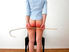 Dirty slut sticks her ass in the air for the cane