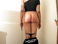 Caned across her big naked backside - severe stripes and weals