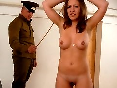 Standing upright fully nude for the Cane