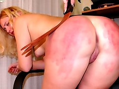 Cute blonde spanked caned and strapped on her large naked bottom