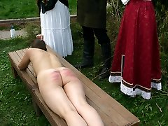 Nude and ashamed - 2 girls caning punishments while strapped down to a bench - burning stripes