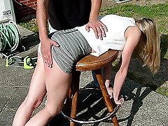 Naughty wife getting her ass spanked hard outdoors