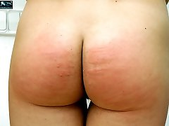 Rock-hard spanking & caning for naked young lovely - well striped ass