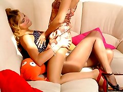 Sexy gal in flying skirt teasing her girlfriend with long legs in lacy hose