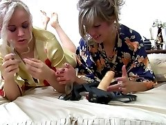 Stockinged lesbians tongue kissing and working pinks with tongues and toys