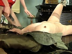 Mischievous mature chick mounts a table for lez making out with a cute babe