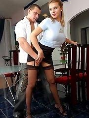 Lusty babe teasing hot guy with her slender legs in black silky stockings