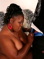 Cockaholic ebony Subrina muching on a big fat black wang before taking it in her cooze