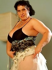 Mature BBW Laszlone does a striptease in front of a younger guy to lure him into lending her his...