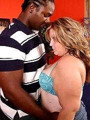 Blonde bbw Dani showing off her fat muff and taking a thick black cock in her mouth and pussy