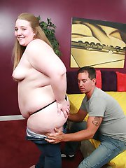 Cute young BBW Shianna spread eagled in bed while a horny guy examines her fat covered muff