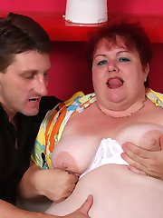 Chunky mature Margaret shows off her flabby knockers to lure a hunk into lending her his shaft