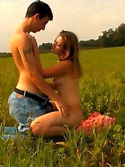 In the field, this super-cute brunette can`t wait to unbutton her sundress and have her mushy body explored by this guy. The field is wide open and someone could see them, but that just turns them on.