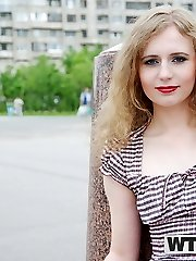 Adorable slut posing in public before having sex - publicsexadventures.com