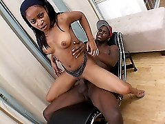 Pimped out ebony teen rides her pussy up and down a massive black dick