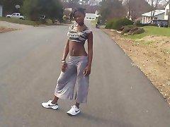 Ebony teen chick flaunts tight body