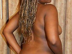 Black fatty showing off her fleshy butt