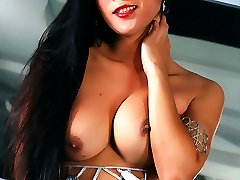 Brunette Asian Tranny with a beautiful face shows off her body