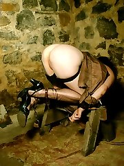 tattoo chick in heels chained in basement dungeon