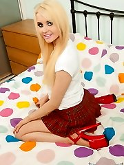 Little cock tease Miss Brook shows off her tight lush arse as she pulls down her school lady mini-skirt
