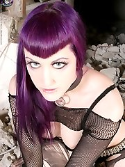 purplehaired cyberpunk in black lingerie and boots