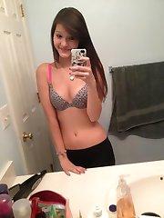 Kinky chick strips naked while selfshooting